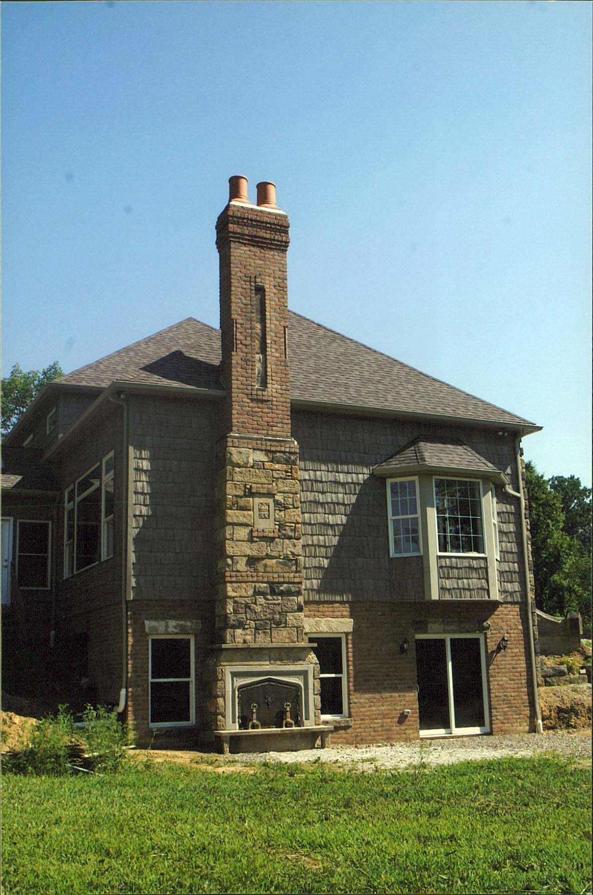 Outdoor fireplace and patio area yoder masonry inc for Stone chimneys