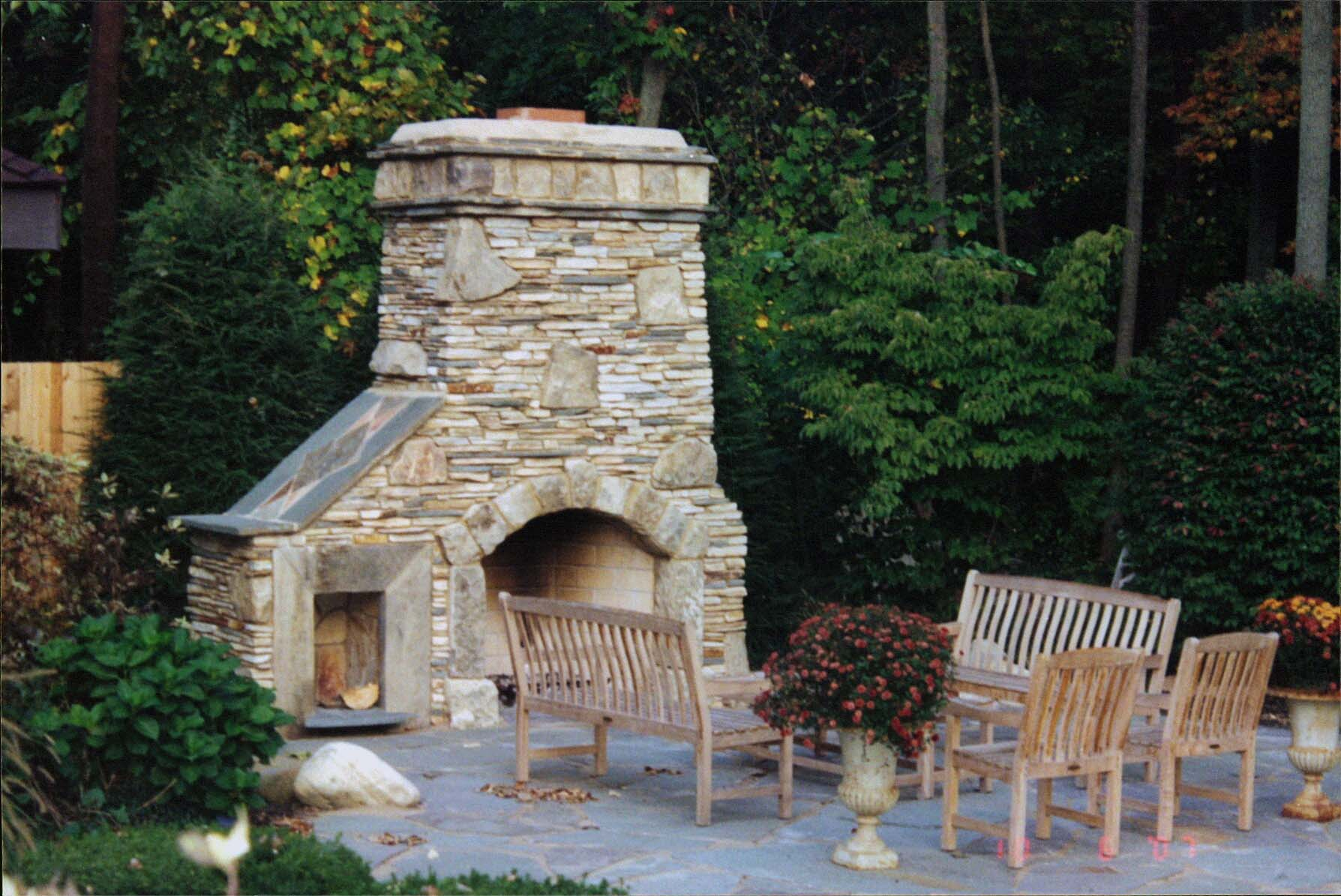 Advertisements & Outdoor fireplace and patio. Natural stone with re-claimed barn ...
