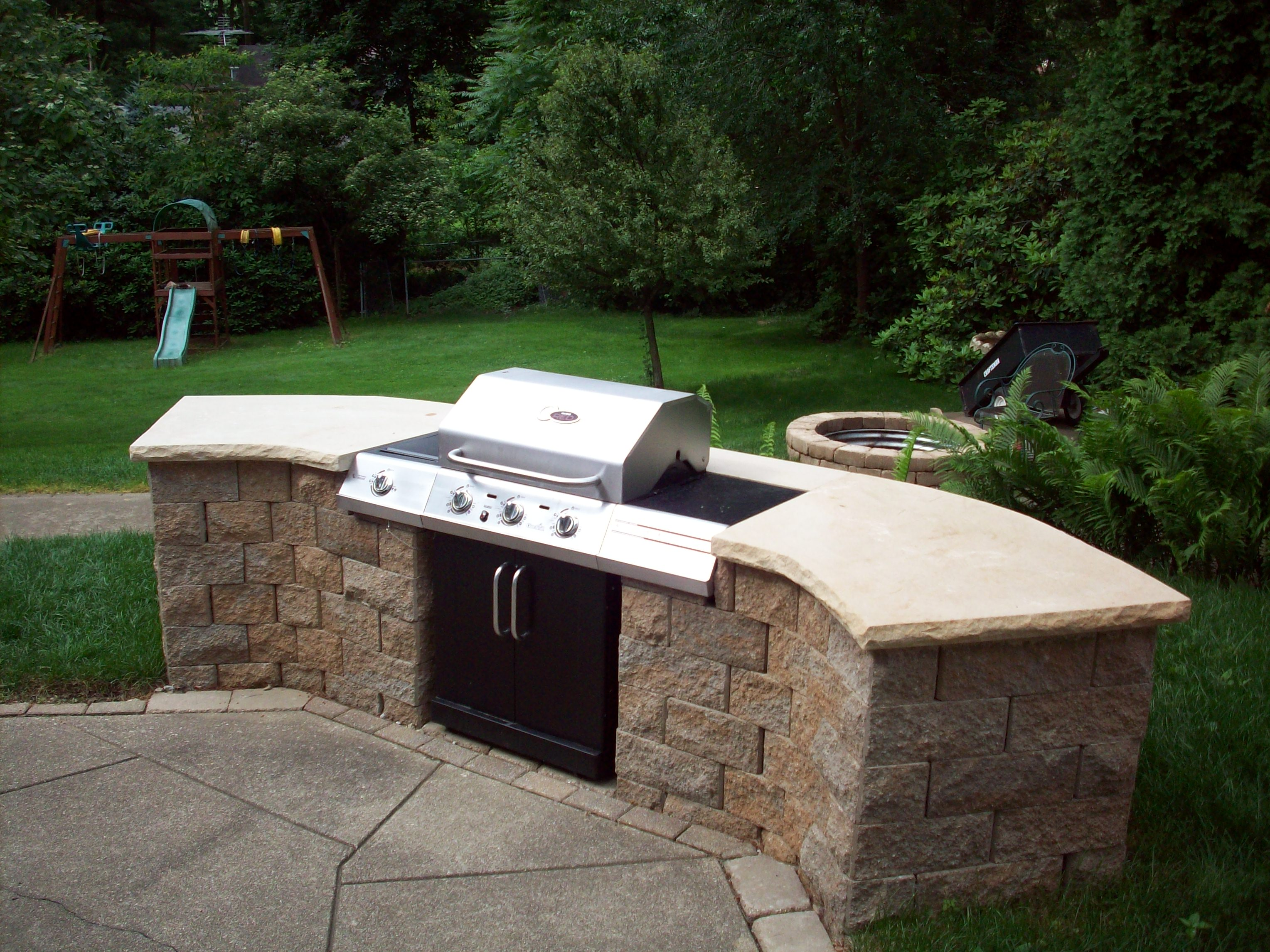 Allen block built-in grill with custom sandstone caps